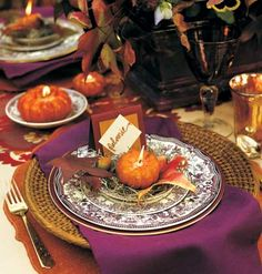 Fall tablescape - Love the purple in the china and linens contrasting with the orange pumpkin and red/yellow in the leaf.