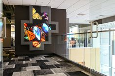 Christie Digital has unveiled a state-of-the-art digital signage lobby that serves as a product showcase for their MicroTiles product line.