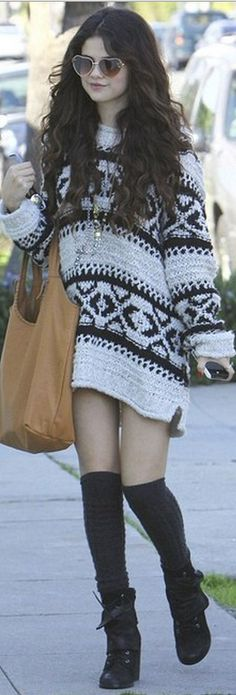 Who made  Selena Gomez's black suede boots, handbag, jewelry, and print sweater?