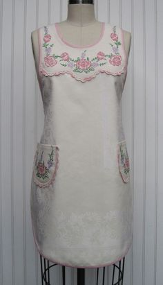 Apron from vintage linens.  At http://qisforquilter.com/2014/03/1920s-style-aprons/.  1920s-Damask-Antimacassar-Apron-front