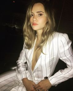 Suki Waterhouse in an Armani stripe suit.
