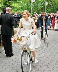 """Laura and Ben coasted away on white bicycles with """"Just Married"""" pennants."""
