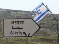 A road sign in English, Hebrew, and Arabic points to the Israeli settlement of Susiya Photo By: AFP PHOTO Breitbart News, Resolutions, Israel, Friday, English, Sign, Signs, English Language, Board