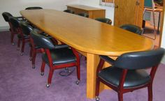 Red oak bankers conference room table by Neal Burns  call 509-466-4684
