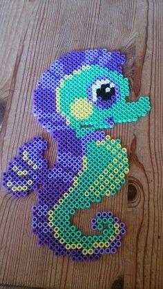 Seahorse cross stitch.
