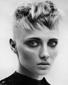 short blond hairstyle with shaved side