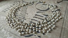 Check out this item in my Etsy shop https://www.etsy.com/listing/503228515/stunning-vintage-pearl-choker-bib