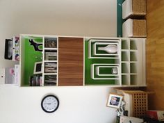 Billy bookcase from Ikea has been pimped out with green foil, a bar and inserts from Parts of Sweden