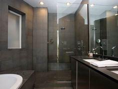Gray masculine modern bathroom design with gray slate tiles, frameless glass shower and black countertops. Grey Slate Bathroom, Grey Slate Tile, Light Grey Bathrooms, Grey Bathrooms Designs, White Marble Bathrooms, Modern Bathroom Tile, Modern Shower, Bathroom Flooring, Man Bathroom