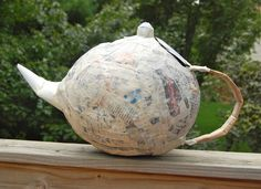 Tea pot pinata. She recommended the glue-water over flour-water-salt method. This could be fun!