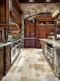 kitchen - stone and dark wood cabinets