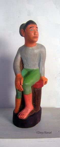 Atleta, madera policromada, 23 x 17 x 60 cm., 2014 del escultor Diego Manuel Rodriguez