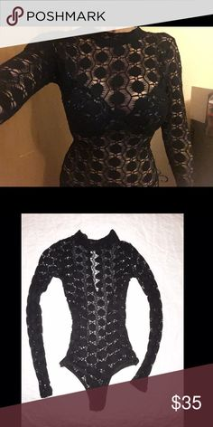 Black body suit Not quite sure of brand. High neck, long sleeve black body suit Tops