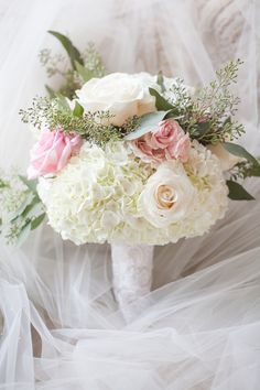 A classic and elegant bouquet for the bride filled with whites and pinks is always perfect in our eyes! | blush pink, Charlotte wedding, Charlotte wedding vendors, Ivory, NC wedding, NC wedding vendors, purple, romantic | Venue @Saratogasprings Photographer @caseyhphotos Florals @chelish Attire @Poffiegirls