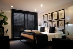 I like the eight pictures used as a focal point over the bed. Master bedroom inspiration!
