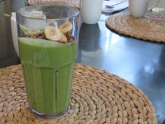 exactly what I've been looking for:  Green Smoothie  (Makes three cups)  Ingredients:½ c. almond milk,  ½ c. avocado,Juice of 1 lemon,1 c. kale  ½ c. spinach leaves,½ c. pineapple   1 tbsp. ginger, minced  1 c. ice cubes    1. Place all ingredients into a blender in the order listed, except ice, and secure lid.  2. Blend on high until ingredients are incorporated; add ice.  3. Blend until smooth.