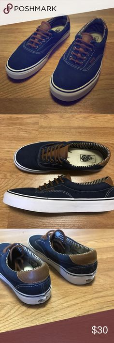 63322129e33373 Blue vans Blue and brown vans. Shows slight wear on insole. Few nicks here