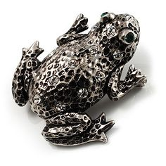 Put a little fun into your jewellery repertoire with this Crystal Toad Brooch. Featuring a leaping frog design, crafted in black tone finish and decorated with clear crystals on the body, offering a sparkling touch. The eyes are depicted with two green crystals for a sparkling look. The brooch measures approximately 40mm x 40mm and fastens with a flag revolver pin. Looks great on pockets, lapels, hats, bags, shoes - or wherever.