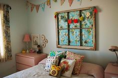 Like the vintage window frame on the wall in place of a headboard... also, the bunting above