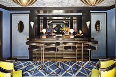 Home bar with navy blue walls and rug.