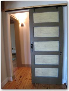 cheaper barn door DIY - You can do these like Shoji doors and instead of rice paper use a milk glass or a light white stain glass that lets light shine through.