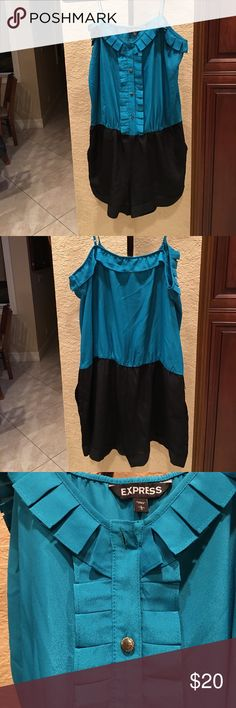 """Super soft comfy beautiful romper. Smoke and pet free home. Like new. Excellent condition. Pretty silk like material. Can wear a black sash or gold /silver belt. 26"""" from strap to bottom. 16"""" wide where colors meet. Express Shorts Skorts"""