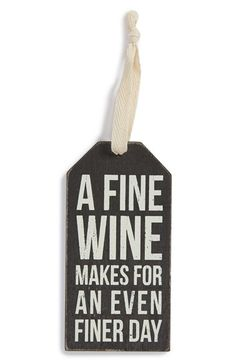 """Free shipping and returns on PRIMITIVES BY KATHY 'Fine Wine' Bottle Tag at Nordstrom.com. Add a touch of rustic charm to any hostess, housewarming or holiday gift with a distressed wooden tag that reads, """"A fine wine makes for an even finer day."""""""