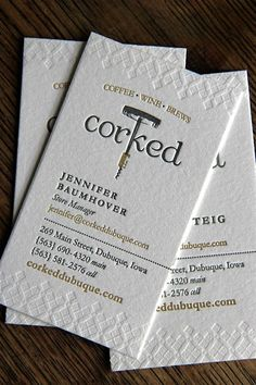 Business cards for Corked Dubuque. Crane Lettra 300gsm Pearl White with blind-impression and two custom Pantone inks.