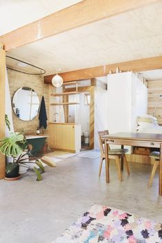 This converted garage in Melbourne, Australia was mostly salvaged or sourced second hand, including the windows, doors, benches, lighting, sinks, and even the bathroom. | Tiny Homes