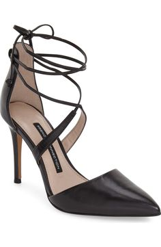 In love with these stunning pointy toe pumps with wraparound lace for a feminine chic look.