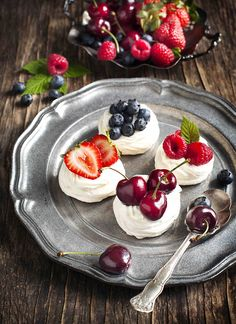 Meringue Nests topped with whipped cream with fresh berries by Anjelagr