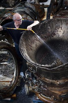 Jim Franko, SpaceWorks Technician, working on an Apollo Thrust Chamber. The components are undergoing cleaning with freshwater and anti-corrosion agents to remove ocean debris and prevent further decay. Apollo 11, Apollo Rocket, Apollo Space Program, Nasa Space Program, Rocket Engine, Apollo Missions, Space Rocket, Space And Astronomy, Aircraft Design