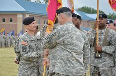 Maj. Gen. James L. Hodge, CASCOM and Fort Lee commanding general, hands the Ordnance School guidon to Col. Edward M. Daly, incoming Ordnance School commandant and Ordnance Corps Chief of Ordnance, during an assumption of command ceremony at Whittington Parade Field June 12.