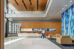Lower counters and cut-outs at the main reception desk and welcome centers on patient floors reflect some of the inclusive design elements at Spaulding Rehabilitation Hospital. Credit: ©Anton Grassl/Esto.