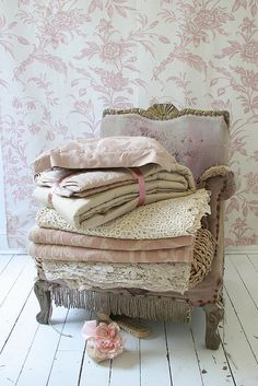 pale pink chair and wallpaper