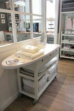 Laundry station cart with basket drawers and ironing board counter top! Absolutely love this!