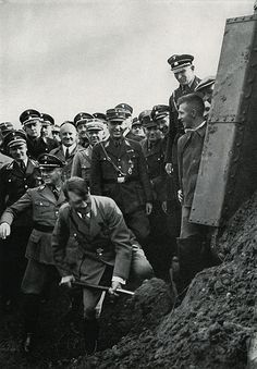 Hitler digging the first shovelful of earth at the ceremony for the Reichsautobahn, Frankfurt, Germany, 1933.