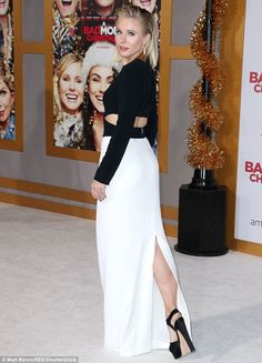 Flanks a lot! The 37-year-old actress looked radiant in a floor-sweeping white skirt paired with a dark, longsleeve blouse that criss-crossed to reveal a hint of her bare flank