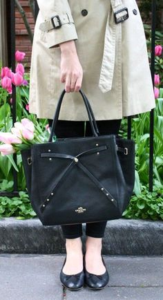 A fabulous refined black leather tote from Coach that is great for a day out shopping. The Turnlock Tie detail is just lovely. #Ad
