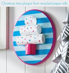 Make your Christmas merry and bright by making this Toilet Paper Roll Tree Plaque Craft to decorate your walls. Though the toilet paper roll craft shown isn't ultra Christmassy, you can choose to use more red and green on your own cardboard craft. Christmas Tree Crafts, Preschool Christmas, Preschool Crafts, Kids Christmas, Christmas Tree Decorations, Green Christmas, Preschool Age, Simple Christmas, Holiday Crafts For Kids