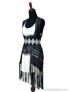"""Skylar wore this sequined dress, belt and black leather vest for her performance of """"Fortunate Son"""" by Creedence Clearwater Revival at the Top 5 performance show."""