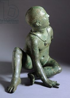 Etruscan bronze statuette of a seated child wearing bulla.Tarquinia C.150 BC. Vatican Etruscan Museum