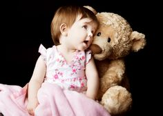Baby Photos by Jo Frances Wellington, Award Winning Photographer - Cute photo of a baby girl cuddling her teddy bear, by Jo Frances