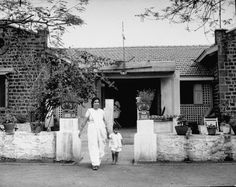 The wife of Indian activist and political leader Jai Prakash Narain departs with her child from Gandhi's nature clinic in 1946. She had been doing volunteer work there. (Margaret Bourke-White—Time & Life Pictures/Getty Images).