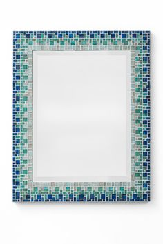 MIRROR DESCRIPTION This mosaic mirror design is part of Opus Mosaics Classic Collection and features high quality three piece frame construction and metallic streaked glass mosaic tile. It is available on a made-to-order basis and is personally handcrafted by mosaic artist Josh Hilzendeger. Available in a variety of standard or custom sizes.  COLOR SCHEME Sky blue, light teal, and light blue with light gray grout.  AVAILABILITY Due to the unique handcrafted nature of this mirror frame and…