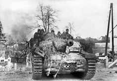 Grenadiers of the SS Panzer Corps on a StuG III assault gun proceed in a war-torn Hungarian village, to counter the Red Army in the area of Lake Balaton, during the third phase of the German operation Army Vehicles, Armored Vehicles, Luftwaffe, Tank Destroyer, Armored Fighting Vehicle, Ww2 Tanks, Battle Tank, Army Soldier, Germany