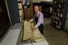 Caked in dust and dating back to 1674, the written records of a growing city are headed to new homes, to be preserved and made accessible to researchers.