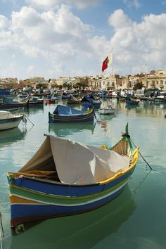 Lunch in  Marsaxlokk (Malta). colourful fishing  boats painted with the eye of  Osiris . The seafront,  lined by excellent fish restaurants,  is a great place for a  long lazy lunch.' http://www.lonelyplanet.com/malta