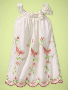This is truly sweet.  I love little white dresses for the summer time.