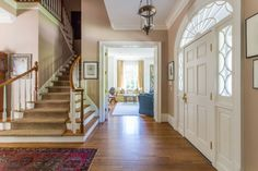 Light, bright foyer that is simple and uncluttered at 65 Asheworth Court-walk to #paceacademy from LoveNowSellLater.
